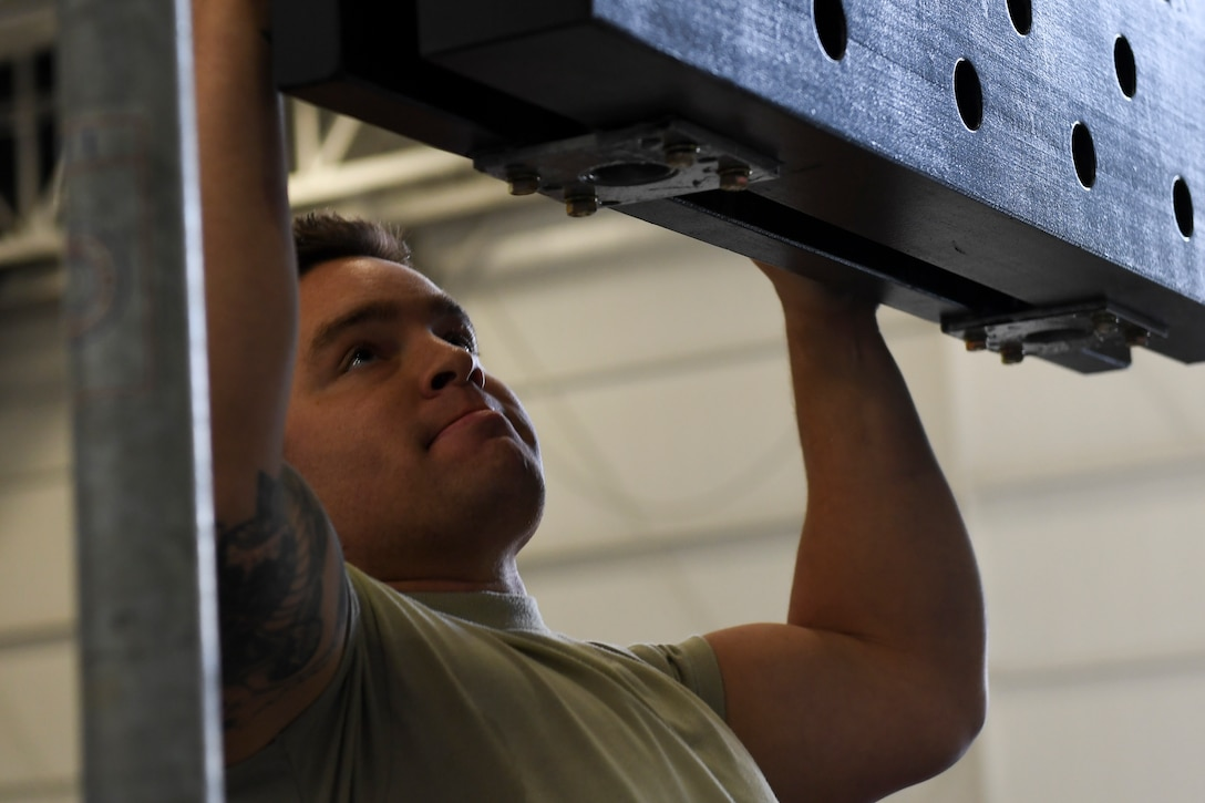 An Airman with the 911th Airlift Wing participates in a time challenge using the Alpha Warrior Battle Rig at the Pittsburgh International Airport Air Reserve Station, Pennsylvania, October 14, 2018. The battle rig is designed to meet all four of the Comprehensive Airman Fitness model's pillars: mental, physical, social and spiritual. (U.S. Air Force photo by Senior Airman Beth Kobily)