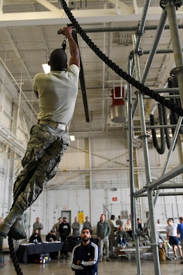 An Airman with the 911th Airlift Wing participates in a time challenge using the Alpha Warrior Battle Rig at the Pittsburgh International Airport Air Reserve Station, Pa., October 14, 2018. The battle rig is designed to meet all four of the Comprehensive Airman Fitness model's pillars: mental, physical, social and spiritual. (U.S. Air Force photo by Senior Airman Beth Kobily)