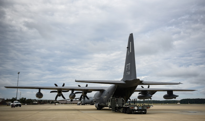 A HC-130J Combat King II from the 71st Rescue Squadron at Moody Air Force Base, Georgia, is loaded by U.S. Air Force Airmen from the 733rd Logistics Readiness Squadron with gear and supplies at Joint Base Langley-Eustis, Virginia, Oct. 17, 2018. The supplies and gear being loaded are for recovery efforts of Tyndall Air Force Base, Florida. (U.S. Air Force photo by Staff Sgt. Carlin Leslie/Released)