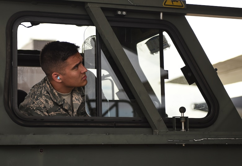 U.S. Air Force Airman First Class Jaxson Doyle, 733rd Logistics Readiness Squadron small air terminal representative, watches loading operations from the K-loader in support of recovery efforts for Tyndall Air Force Base, Florida, at Joint Base Langley-Eustis, Virginia, Oct. 17, 2018. The supplies and gear being loaded are for recovery efforts of Tyndall Air Force Base, Florida. (U.S. Air Force photo by Staff Sgt. Carlin Leslie/Released)