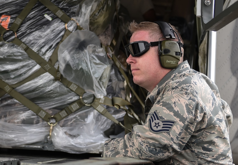 U.S. Air Force Staff Sgt. John Wilson, 733rd Logistics Readiness Squadron deployment readiness, waits for the order to pull chaulks during a loading operation supporting the Tyndall Air Force Base, Florida, recovery efforts at Joint Base Langley-Eustis, Virginia, Oct. 17, 2018. The HC130J Combat King II is from the 71st Rescue Squadron at Moody Air Force Base, Georgia. (U.S. Air Force photo by Staff Sgt. Carlin Leslie/Released)