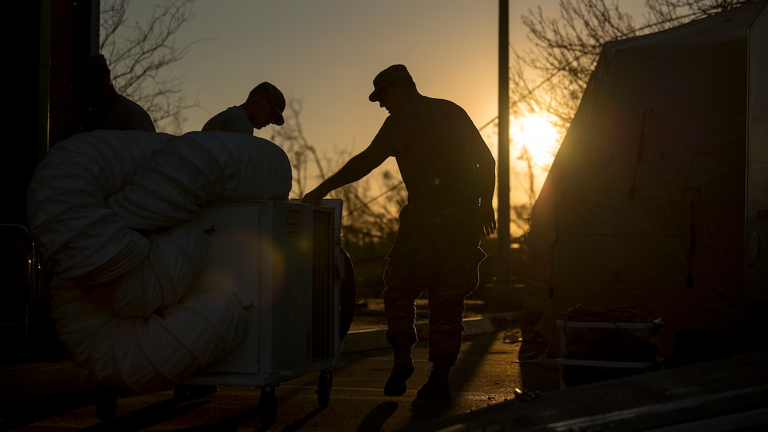Airmen from the 290th Joint Communications Support Squadron work around the clock to provide communication services Oct. 13, 2018, aiding Hurricane Michael recovery efforts. These trained experts are located throughout the panhandle providing communication services for the emergency operations centers of Bay, Jackson, Holmes, Washington and Liberty counties, supporting hundreds of first responders in the community. (U.S. Air Force photo by Airman 1st Class Caleb Nunez)