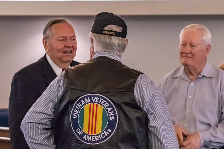 David Miller talks with friends at a ceremony where he was presented the Distinguished Flying Cross Award at Nacogdoches, Texas, Oct. 13, 2018. Miller earned the award for his actions during a tour in the Vietnam War. (U.S. Air Force photo by Tech. Sgt. Cody Burt/Released)