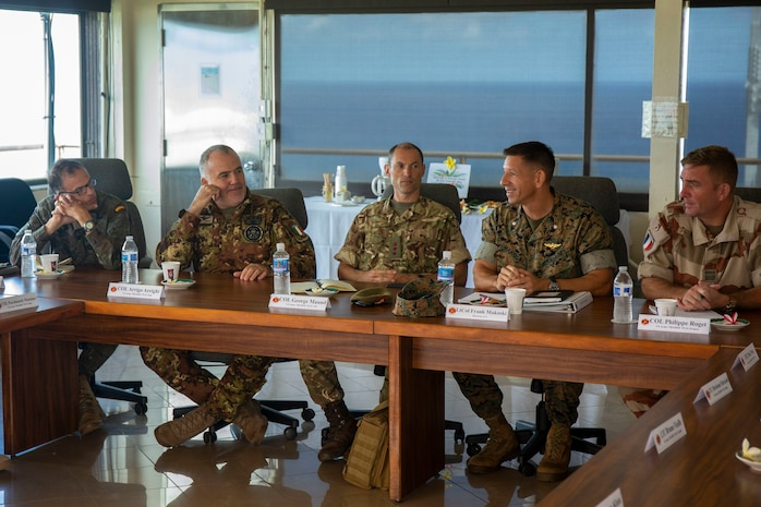 U.S. Marine Corps Lt. Col. Frank Makoski (second from the right), director, S-3, Marine Corps Base Hawaii (MCBH), speaks to U.S. and foreign Service members with U.S. Army Training Doctrine Command (TRADOC) liaisons at the Kansas Tower classroom during a tour of MCBH, Oct. 16, 2018. TRADOC liaisons visited the base to learn about the advantages of the unique training areas around Hawaii. (U.S. Marine Corps photo by Sgt. Zachary Orr)