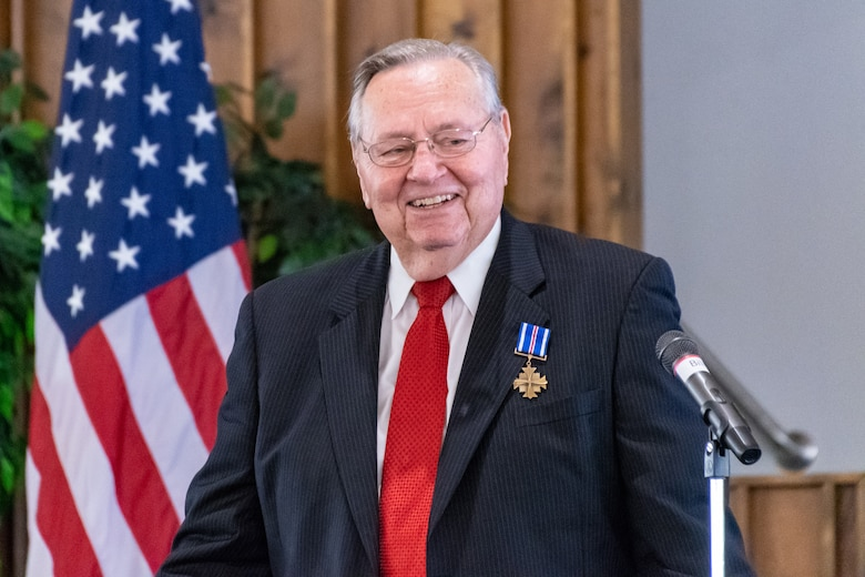 David Miller smiles as he gives a speech after being presented the Distinguished Flying Cross Award at Nacogdoches, Texas, Oct. 13, 2018. This presentation came 50 years after he earned the award for his actions during a tour in the Vietnam War. During his time there, he intercepted enemy radio communications that saved countless American lives. (U.S. Air Force photo by Tech. Sgt. Cody Burt/Released)