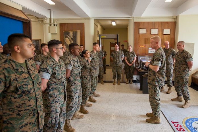 U.S. Marine Corps Brig. Gen. Paul J. Rock Jr., commanding general, Marine Corps Installations Pacific, speaks to U.S. Marines with Legal Services Support Team at the legal building during his visit to Marine Corps Base Hawaii, Oct. 15, 2018. From being MCIPAC's meritorious sergeant nominee to Hawaii's USO service member of the year, Rock recognized four Marines then sat down and enjoyed chow with them and along other MCBH Marines. (U.S. Marine Corps photo by Sgt. Zachary Orr)