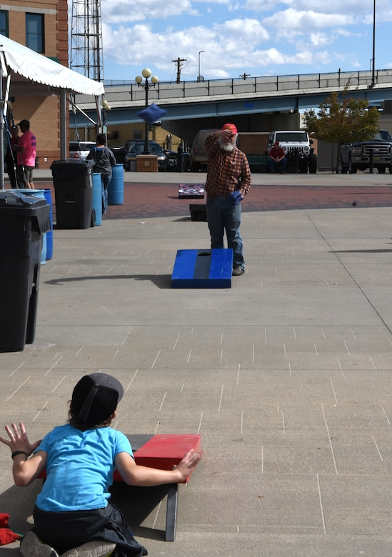 Local community members play cornhole during the first county-wide Fire Prevention Week Open House in Cheyenne, Wyo., on Oct. 13, 2018. The local community enjoys the festivities during the Fire Prevention Week Open House.