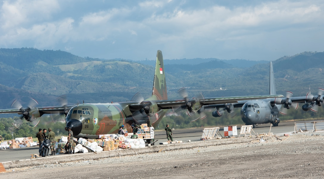 Two C-130s from the Indonesian and Royal New Zealand Air Force lands at the airport in Palu, Indonesia Oct. 10, 2018. As of Oct. 15, 2018, military members assigned to the 374th Airlift Wing from Yokota Air Base, Japan and the 36th Contingency Response Group have transported and offloaded over 543,373 lbs. of humanitarian supplies in Balikpapan, as well as 255 passengers. Collectively the U.S. Air Force and our multinational partners have downloaded 1,534,140 lbs. of cargo and transported 333 displaced people from Palu, Indonesia. (U.S. Air Force photo by Master Sgt. JT May III)