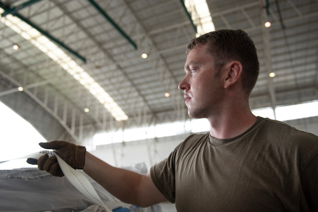 U.S. Air Force Staff Sgt. Keaton Truman, 36th Mobility Response Squadron crew chief, at Andersen Air Force Base, Guam, builds a pallet with humanitarian supplies from China in Balikpapan, Indonesia Oct. 11, 2018. In support of USAID's response efforts, military members assigned to the 374th Airlift Wing from Yokota Air Base, Japan and the 36th Contingency Response Group, at Andersen Air Force Base, Guam have transported and offloaded over 543,373 lbs. of humanitarian supplies in Balikpapan, as well as 255 passengers. Collectively the U.S. Air Force and, our multinational partners have downloaded 1,534,140 lbs. of cargo and transported 333 displaced people from Palu, Indonesia. (U.S. Air Force photo by Master Sgt. JT May III)