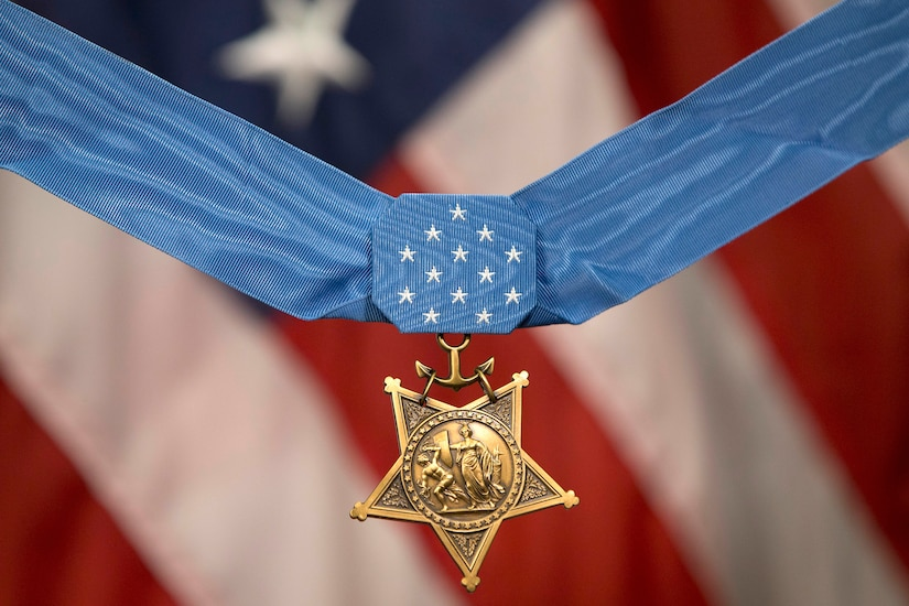 View of the Medal of Honor, with an American flag as the backdrop.