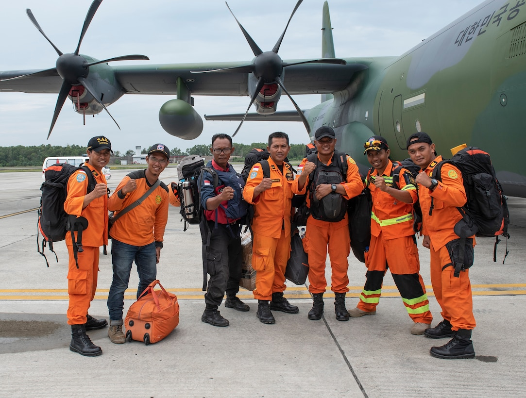 An Indonesian Search and Rescue team poses for a photo before their departing the airport in Balikpapan, Indonesia Oct. 12, 2018 The Indonesian Government and U.S. Agency for International Development are working alongside 15 countries agencies and foreign militaries ensuring supplies, airlift, shelter and medical support reach those affected. (U.S. Air Force photo by Master Sgt. JT May III)