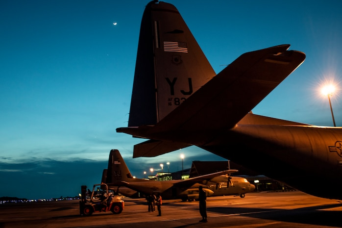 Three U.S. C-130 Hercules aircraft rest on the flight line in Balikpapan, Indonesia Oct. 12, 2018. Pilots, aircrew and security forces members from the 374th Airlift Wing and 36th Airlift Squadron have flown up to three sorties daily to ensure humanitarian supplies reach thousands. More than 543,373 lbs. of supplies have been transported on U.S. aircraft, 255 passengers and approximately 47 displaced people from Palu. (U.S. Air Force photo by Master Sgt. JT May III)