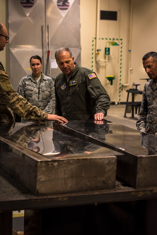 U.S. Air Force Tech. Sgt. Jordon Jones, left, a 35th Maintenance Squadron aircraft structural maintenance craftsman, explains to Lt. Gen. Jerry P. Martinez, center, the U.S. Forces Japan and Fifth Air Force commander, and his command chief, Chief Master Sgt. Terrence Greene, right, the significance of adding pieces of sheet metal to engine test facility equipment during their visit at Misawa Air Base, Japan, Oct. 11, 2018. The chief said USFJ's Airmen are incredibly talented when it comes to innovative ideas and continue stepping up, making every dollar count and saving taxpayer dollars. (U.S. Air Force photo by Tech. Sgt. Benjamin W. Stratton)