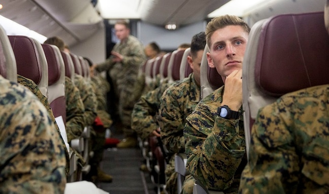 U.S. Marines with II Marine Expeditionary Force standby for takeoff aboard a Boeing 767-200ER aircraft at Marine Corps Air Station Cherry Point, North Carolina, Oct. 10, 2018.