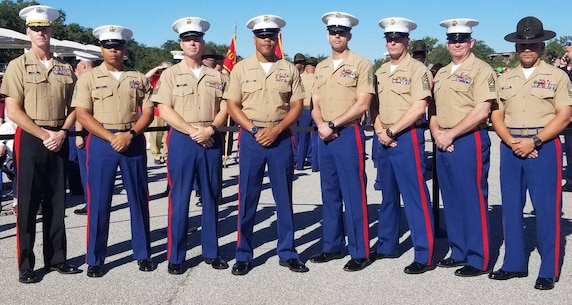 Brig. Gen. James F. Glynn, the commanding general of Eastern Recruiting Region and Marine Corps Recruit Depot Parris Island, S.C., attends a recruit graduation ceremony with sergeants major throughout ERR and 6th Marine Corps District, at MCRD Parris Island, Oct. 12, 2018.   From left to right, the sergeants major are Sgt. Maj. Timothy O. Clay, Recruiting Station Atlanta; Sgt. Maj. Devlin Root, Recruiting Station Montgomery; Sgt. Maj. Cortez L. Brown, 6th Marine Corps District; Sgt. Maj. Joshua Figueredo, Recruiting Station Charlotte; Sgt. Maj. John D. Dober, Recruiting Station Fort Lauderdale; Sgt. Maj. Daniel D. Moore, Recruiting Station Columbia; and Sgt. Maj. Rafael Rodriguez, ERR and MCRD Parris Island.