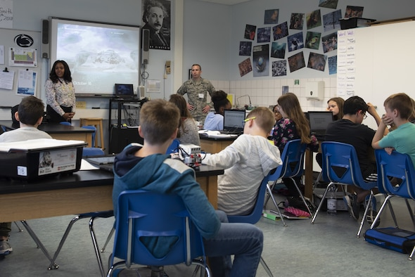U.S. Air Force Tech. Sgt. Thomas Pennington, 372nd Training Squadron auxiliary ground equipment instructor, talks with Spangdahlem Middle School's Applied Technology class at Spangdahlem Air Base, Germany, Oct. 16, 2018. The purpose of the visit is to show students the real-world application of skills and knowledge they are learning in the classroom. (U.S. Air Force photo by Airman 1st Class Branden Rae)