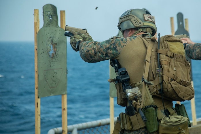 A reconnaissance Marine with the 31st Marine Expeditionary Unit's Amphibious Reconnaissance Platoon fires an M1911 .45 caliber-pistol during marksmanship training aboard the amphibious assault ship USS Wasp, underway in the East China Sea, Oct. 17, 2018. Marines with ARP specialize in reconnaissance, surveillance and close-quarters tactics during amphibious operations. The 31st MEU, the Marine Corps' only continuously forward-deployed MEU, provides a flexible force ready to perform a wide-range of military operations in the Indo-Pacific region.