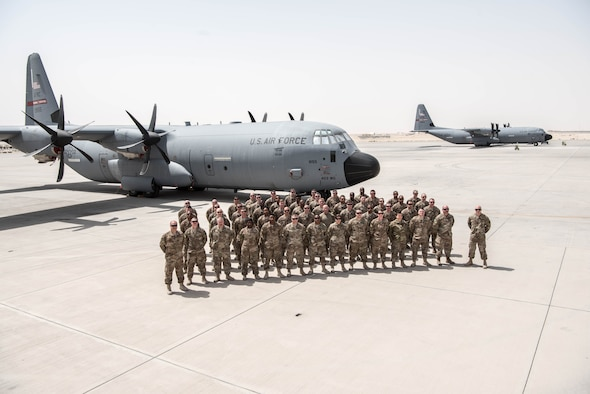 Members of the Air Force Resever 803rd Maintenance Squadron pose with a Flying Jennies C-130J.  The 803rd AMXS completed its first deployment since its induction into the 403rd Wing.   (U.S. Air Force photo by 403rd Wing Public Affairs)