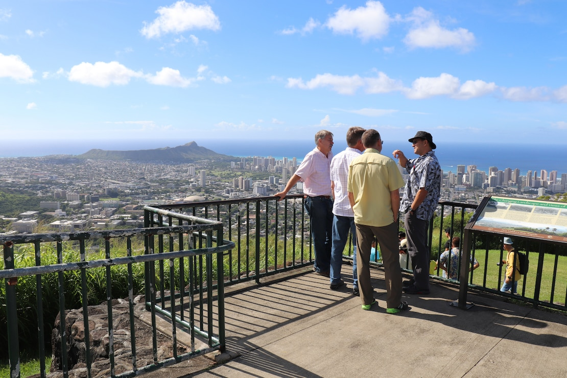 HONOLULU, Hawaii (Oct. 16, 2018) -- Honolulu District Environmental Branch Chief Michael Wong (center right) explains some of the nuances of the Ala Wai Watershed to USACE enterprise personnel during a field trip to the Ala Wai Charette hosted by Honolulu District included a site visit to Tantalus, Manoa Stream, Waiakeakua, Kanewai Field, Pukele Streams, and the Ala Wai Canal during the three-day Ala Wai Watershed Flood Mitigation Design Charrette