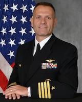 Official bio photo of Captain Michael F. Black, Commander, Task Force 124