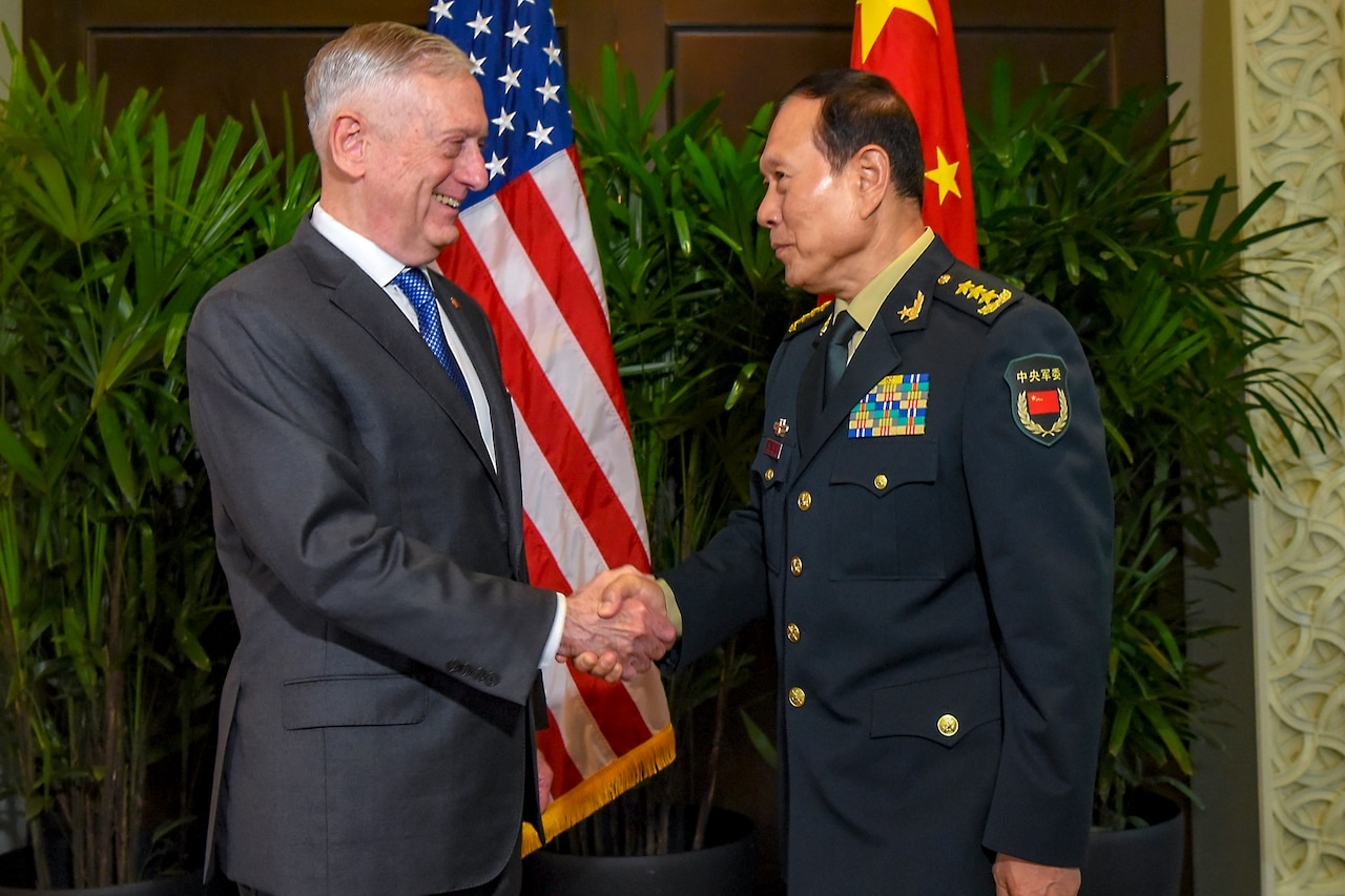Defense Secretary James N. Mattis shakes hands with Chinese Defense Minister Gen. Wei Fenghe.