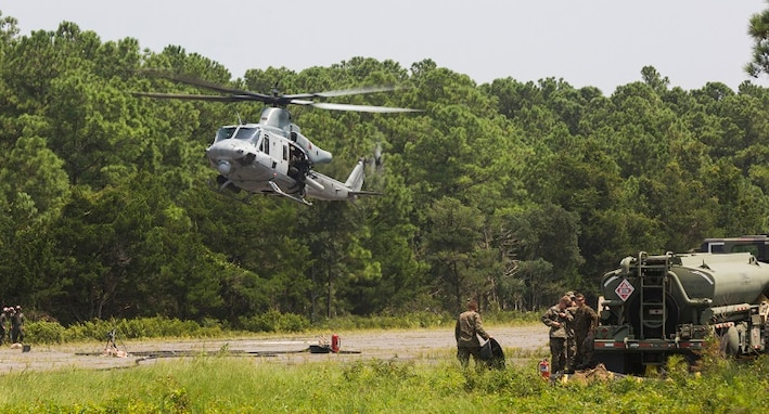A U.S. Marine Corps UH-1Y Huey with Marine Light Attack Helicopter Squadron (HMLA) 167 arrives at a forward arming and refueling point (FARP) on Marine Corps Outlying Landing Field Atlantic, N.C., Aug. 14, 2018.