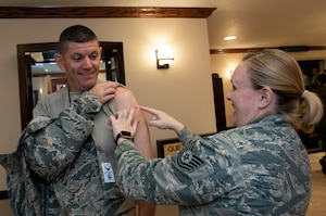 U.S. Air Force Chief Master Sgt. Derek Crowder, command chief, 60th Air Mobility Wing is administered his seasonal influenza vaccination by Tech. Sgt. Kelly Manibusan, non-commissioned officer in charge of the David Grant USAF Medical Center's Allergy/Immunology, Oct. 10, 2018, Travis Air Force Base, Calif.  (U.S. Air Force Photo by Heide Couch)