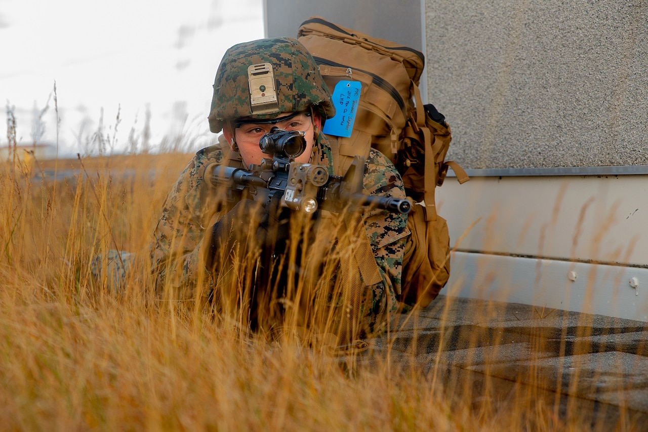 A Marine provides security for his team during Exercise Trident Juncture 18.