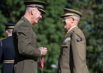 Marine Corps Gen. Joe Dunford, chairman of the Joint Chiefs of Staff, presents a Legion of Merit Award to Spain's Chief of Defence Gen. Fernando Alejandre Martinez during an Armed Forces Full Honor Arrival Ceremony in Washington, D.C., Oct. 18, 2018.