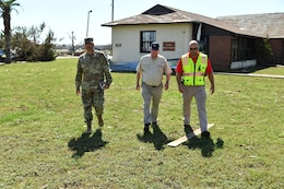 Col. Sebastien P. Joly, U.S. Army Corps of Engineers Mobile District commander, Wynne Fuller, Chief Operations Division Mobile District and Jonathan Carr, USACE Tyndall AFB resident engineer, assess the damage to the USACE Resident Office on Oct. 17, 2018 at Tyndall AFB, Fla. Hurricane Michael's direct hit on Oct. 10, 2018 severely damaged Tyndall AFB Resident Office