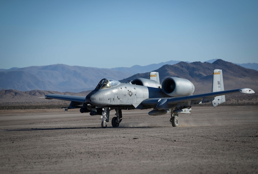 An A-10 Thunderbolt II assigned to the 66th Weapons School (WPS) at Nellis Air Force Base, Nevada, prepares for takeoff Oct. 5, 2018 at Ft. Irwin, California. The 66th WPS Weapons Instructor Course pilots flew as forward air control in support of Green Flag West 19-01 held at Ft Irwin. (U.S. Air Force photo by Airman Bailee A. Darbasie)