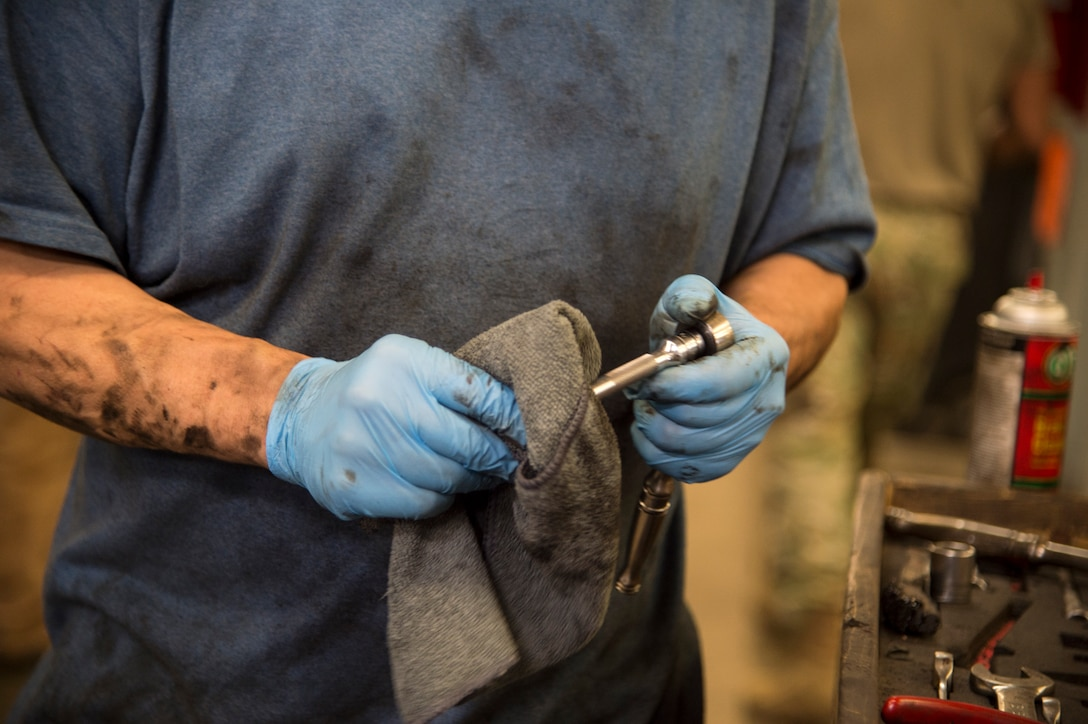 Chris Blankenship cleans tools used to remove the transmission from his vehicle at the Auto Skills Center at Joint Base Elmendorf-Richardson, Alaska, Oct. 17, 2018. The Auto Skills Center is home to a full array of equipment, tools and knowledgeable staff for do-it-yourself maintenance and repair to personal vehicles.