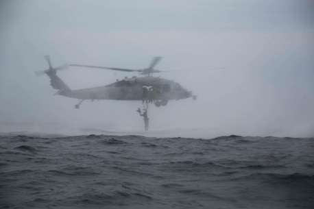 U.S. Marines with the 31st Marine Expeditionary Unit's Amphibious Reconnaissance Platoon exit a U.S. Navy MH-60S Seahawk helicopter during Helocast and Special Patrol Insertion and Extraction training, underway in the East China Sea, Oct. 14, 2018. The Seahawk belongs to Helicopter Sea Combat Squadron 25. Helocasting and SPIE operations allow the recon Marines to enter and exit tactical landing zones that are inaccessible to helicopters during amphibious operations. The 31st MEU, the Marine Corps' only continuously forward-deployed MEU, provides a flexible force ready to perform a wide-range of military operations in the Indo-Pacific region. (U.S. Marine Corps photo by Lance Cpl. Kealii De Los Santos)