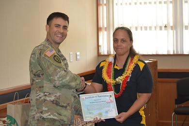 Honolulu District Deputy Commander Maj. Thomas Piazze stands with U.S. Army Reserve Sgt. Kawaiola Nahale as the guest speaker for Women's History Month.  Nahale spoke about competing in the 2016 Department of Defense Warrior Games held at the United States Military Academy at West Point, N.Y.  Based on her swim times at the trials there, she qualified to compete in both the Warrior Games and Invictus Games. Nahale is a Financial Analyst with the U.S. Army Reserve's 311th Signal Command based at Fort Shafter, Hawaii