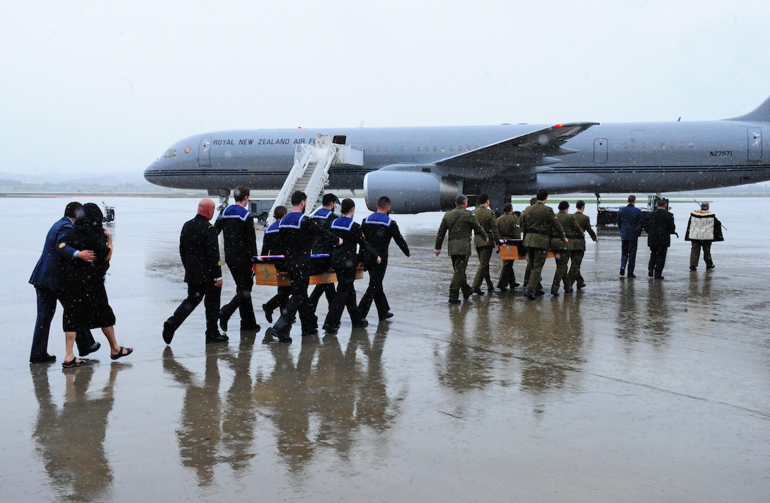 Members from the Maori Cultural Group and Pallbearers from the New Zealand Te Auraki Project escort remains of PJ Mollison and HL Herbert Lester Humm on the tarmac at Osan Air Base, Republic of Korea, Oct. 5, 2018. As part of a project called Te Auraki (The Return), the New Zealand Defense Force returns personnel and dependents buried overseas after January 1955 back home to New Zealand. (U.S. Army Sergeant Benjamin Parsons)