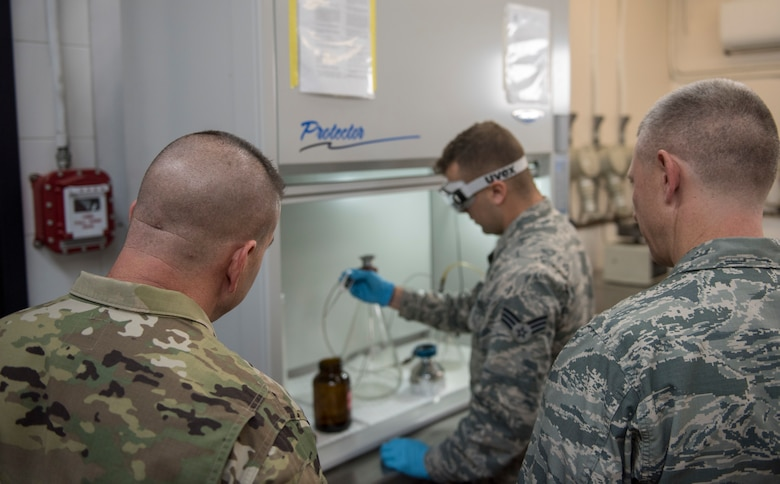 39th Logistics Readiness Squadron fuels laboratory technician briefs the 39th Air Base Wing commander and command chief.
