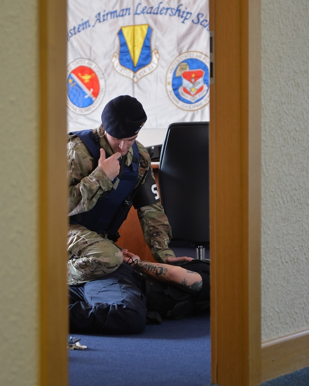 U.S. Air Force 2nd Lt. Stephen Cromp, 569th U.S. Forces Police Squadron flight commander, talks into his radio during an active shooter exercise at Ramstein Airman Leadership School on Vogelweh Military Complex, Germany, Oct. 16, 2018. After apprehending the shooter, security forces cleared the building to ensure there were no additional threats. (U.S. Air Force photo by Staff Sgt. Jimmie D. Pike)