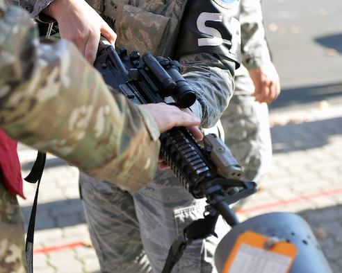 A U.S. Airman clears out his weapon during an active shooter exercise at Ramstein Airman Leadership School on Vogelweh Military Complex, Germany, Oct. 16, 2018. During the exercise safety of all participants was a primary concern. (U.S. Air Force photo by Staff Sgt. Jimmie D. Pike)