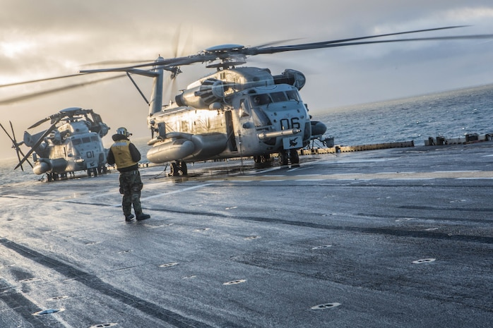 A U.S. Marine Corps CH-53 Sea Stallion prepare for takeoff aboard USS Iwo Jima Oct 17, in preparation of Exercise Trident Juncture 2018. Trident Juncture is a planned exercise to enhance U.S. and NATO partners' and Allies' ability to work together collectively and conduct military operations under challenging conditions.