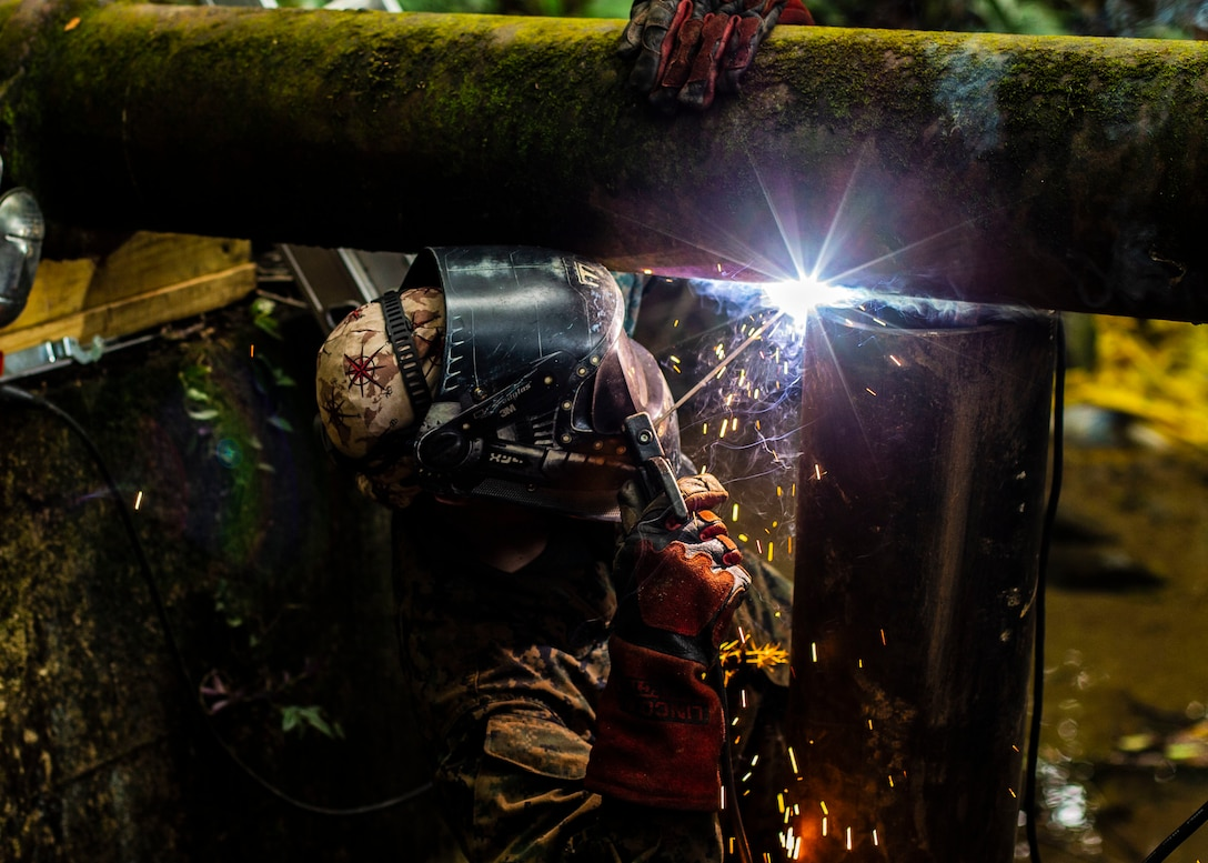 U.S. Marine Staff Sgt. Immanuel Garcia, a metal worker with Special Purpose Marine Air-Ground Task Force – Southern Command welds a support beam to support the pipe the Marines are replacing on Sep 19, 2018 in Trujillo, Honduras. The water valve was stuck at 80% shut-off effecting 6 local communities containing roughly 8,000 people. The Marines repaired the pipe to return water to the local communities. The Marines and sailors of SPMAGTF-SC are conducting security cooperation training and engineering projects alongside partner nation military forces in Central and South America. The unit is also on standby to provide humanitarian assistance and disaster relief in the event of a hurricane or other emergency in the region.