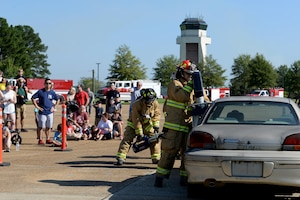 Fourteenth Civil Engineer firefighters, demonstrates during an open house their ability to rescue an individual from a vehicle Oct. 6, 2018, on Columbus Air Force Base, Mississippi. The 14th CES firefighters respond to aircraft and facility emergencies within minutes and have the ability to control, contain and stop numerous types of emergencies from escalation. (U.S. Air Force photo by Airman Hannah Bean)