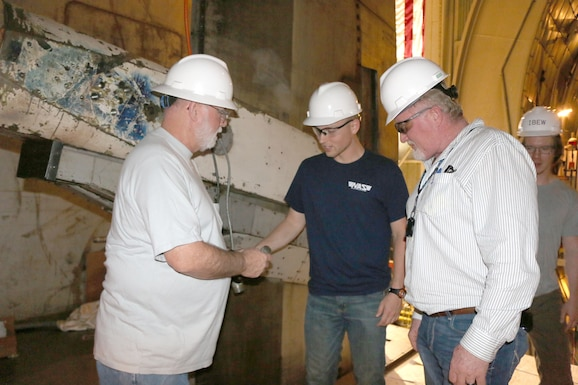 AEDC electricians Jimmy Newman, left, Andy Grissom, center, and Brian Roper, right, inspect the hookup cables for the pitch boom on the S-cart for the 16-foot Supersonic wind tunnel at Arnold Air Force Base. Pictured in back is Bradford Stirewalt looking on. (U.S. Air Force photo by Deidre Ortiz)
