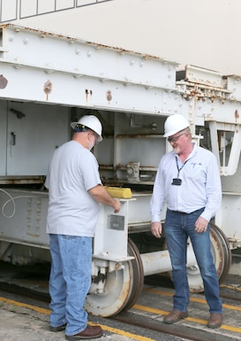 AEDC electrician Brian Roper, right, watches as electrician Jimmy Newman, at left, operates a transfer cart at the Propulsion Wind Tunnel Facility at Arnold Air Force Base. The transfer cart is used to move a test model from Model Installation Building to the test cell.  (U.S. Air Force photo by Deidre Ortiz)