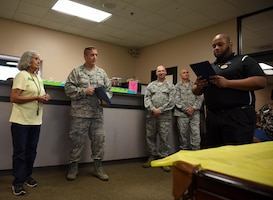 Elisa Quintero, 14th Force Support Squadron Youth Programs operations clerk, is read her Certificate of Service, thanking her for 50 years of service under the Air Force, August 13, 2018, on Columbus Air Force Base, Mississippi. (U.S. Air Force photo by Airman 1st Class Keith Holcomb)