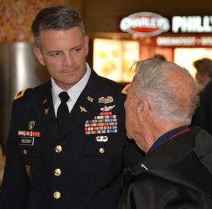 Army Col. Peter Velesky, vice commander, 502nd Air Base Wing and Joint Base San Antonio, speaks with a World War II veteran before the start of a sendoff ceremony at the San Antonio International Airport Oct. 17, which saw 40 WWII veterans take off for a trip to New Orleans to visit the National World War II Museum. The Soaring Valor program, sponsored by the Gary Sinise Foundation, helped send the veterans and 40 high school Student companions from Dallas, to the museum.