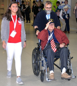 A World War II veteran salutes at the start of a sendoff ceremony at the San Antonio International Airport Oct. 17, which saw 40 WWII veterans take off for a trip to New Orleans to visit the National World War II Museum. The Soaring Valor program, sponsored by the Gary Sinise Foundation, helped send the veterans and 40 high school Student companions from Dallas, to the museum.