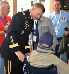 Lt. Gen. Jeffrey Buchanan, commanding general, U.S. Army North (Fifth Army) from Joint Base San Antonio-Fort Sam Houston, greets a World War II veteran before a sendoff ceremony at the San Antonio International Airport Oct. 17, which saw 40 WWII veterans take off for a trip to New Orleans to visit the National World War II Museum. The Soaring Valor program, sponsored by the Gary Sinise Foundation, helped send the veterans and 40 high school Student companions from Dallas, to the museum.