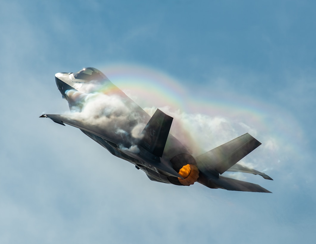 """Capt. Andrew """"Dojo"""" Olson, F-35 Heritage Flight Team pilot and commander, performs a vertical climb in an F-35A Lightning II during the Bell Fort Worth Alliance Air Show Oct. 14, 2018, in Fort Worth, Texas. The F-35A Lightning II's F-135 single-engine contains 43,000 pounds of thrust. (U.S. Air Force photo by Senior Airman Alexander Cook)"""