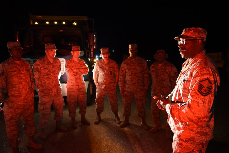 Master Sgt. Terry Kelly, a civil engineering operations manager, addresses Airmen assigned to the 165th Airlift Wing before returning to relief operations for Hurricane Michael in Seminole County, Ga., Oct. 14, 2018. The Georgia Air National Guard is working with the Georgia Emergency Management Agency and local authorities to conduct route clearance and debris removal. (U.S. Air National Guard photo by Tech. Sgt. Amber Williams)