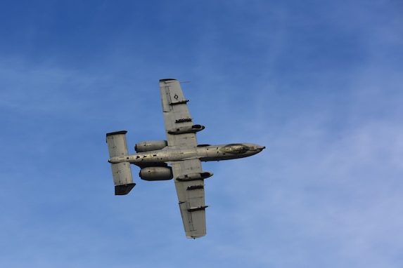 "An A-10 Thunderbolt II performs aerial maneuvers before the start of a Fallen Hawg remembrance ceremony Oct. 17, 2018, at Whiteman Air Force Base, Mo. The remembrance ceremony was held in honor of fallen A-10 pilots and signals the start of 2018 Hawgsmoke competition, which is a biennial worldwide A-10 bombing, missile and tactical gunnery competition derived from the discontinued ""Gunsmoke"" Air Force Worldwide Gunnery Competition. (U.S. Air Force photo by Staff Sgt. Joel Pfiester)"